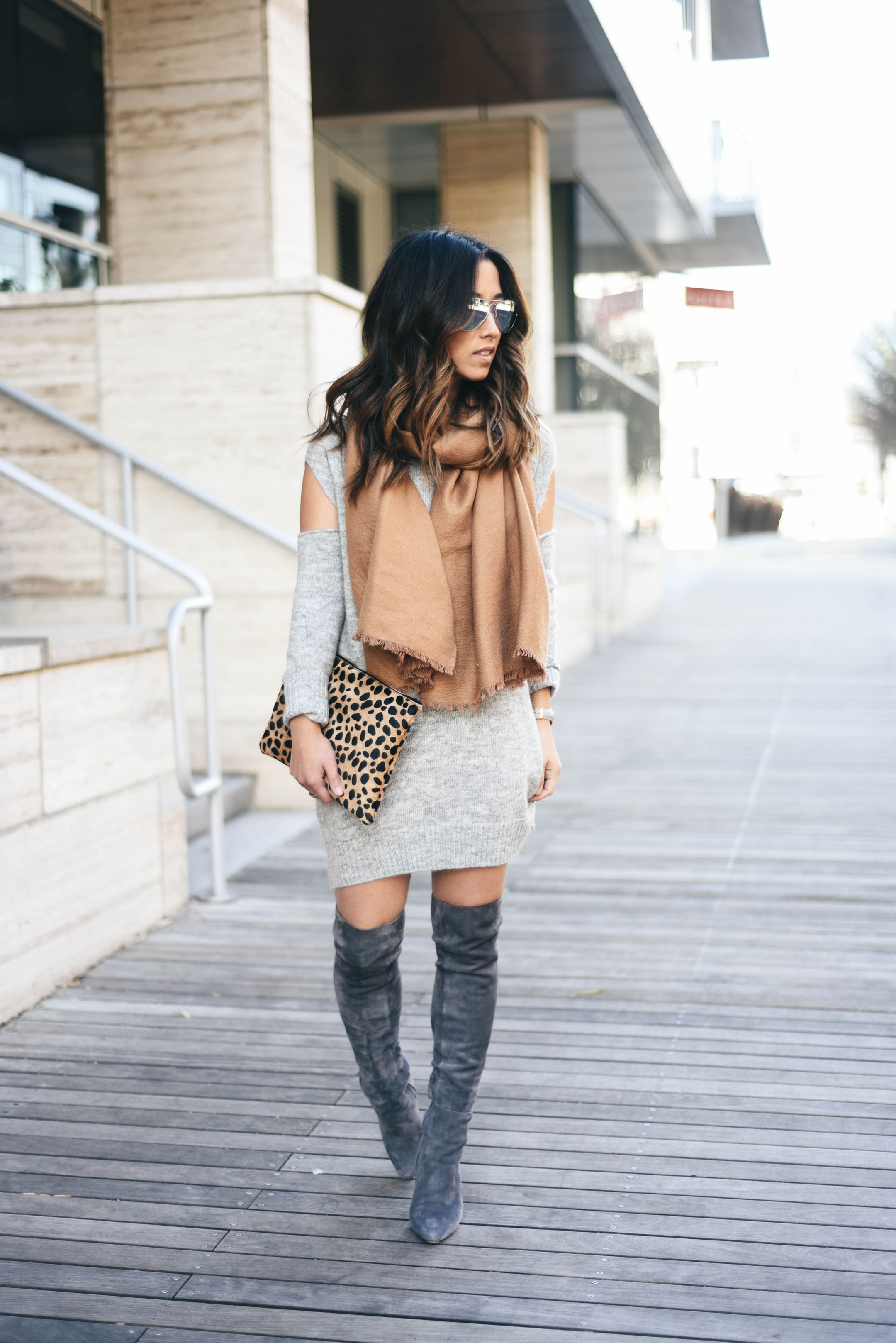over the knee boots style with a sweater dress