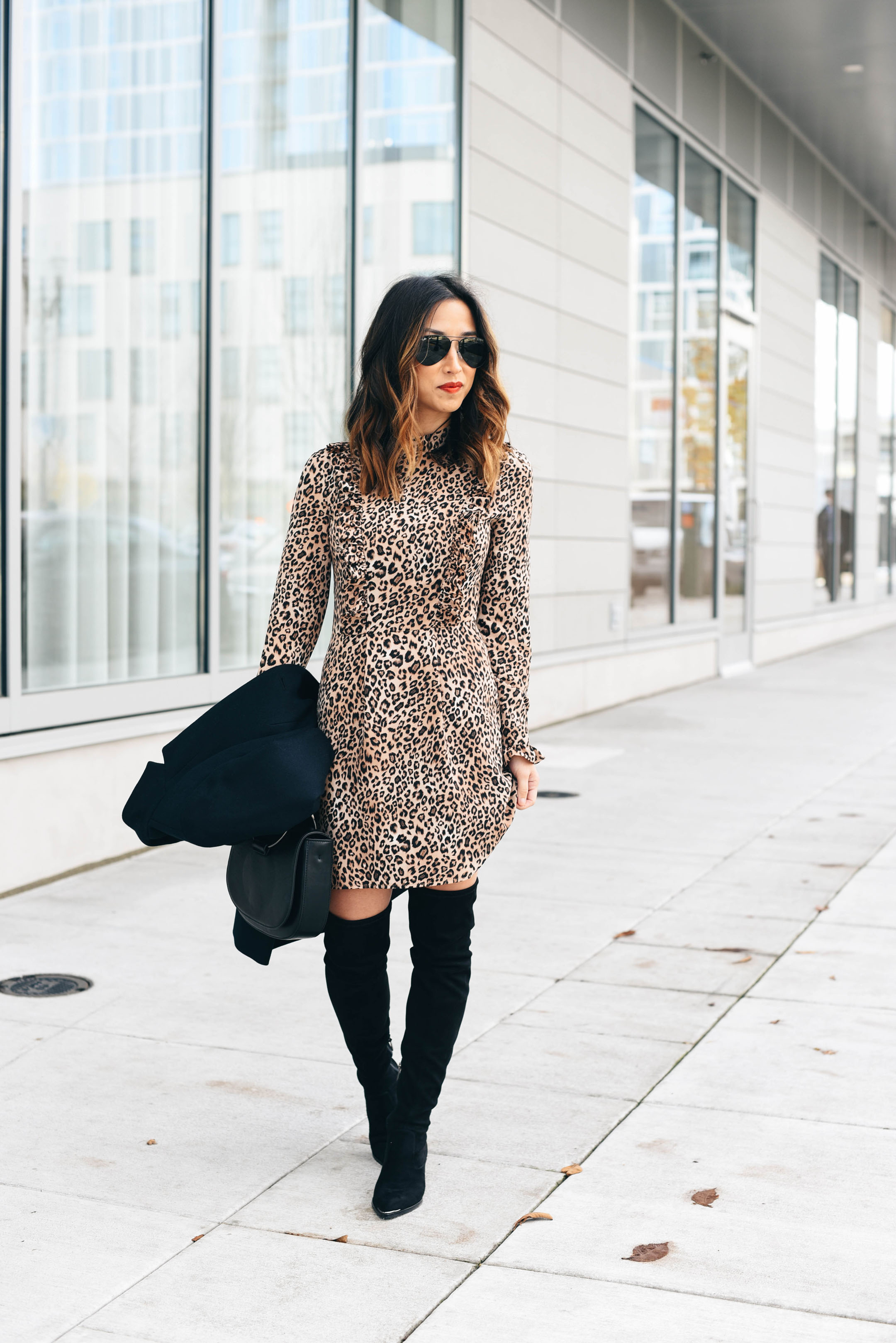 over the knee boots styled with a dress