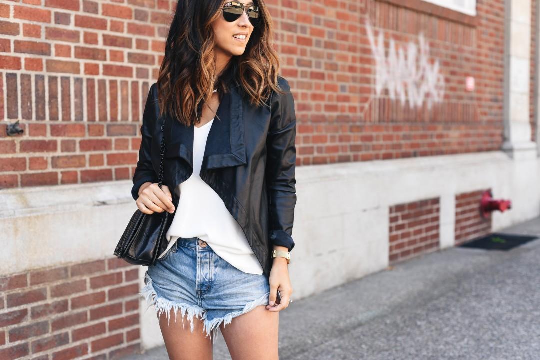 Crystalin Marie wearing BB Dakota Peppin drape front faux leather jacket