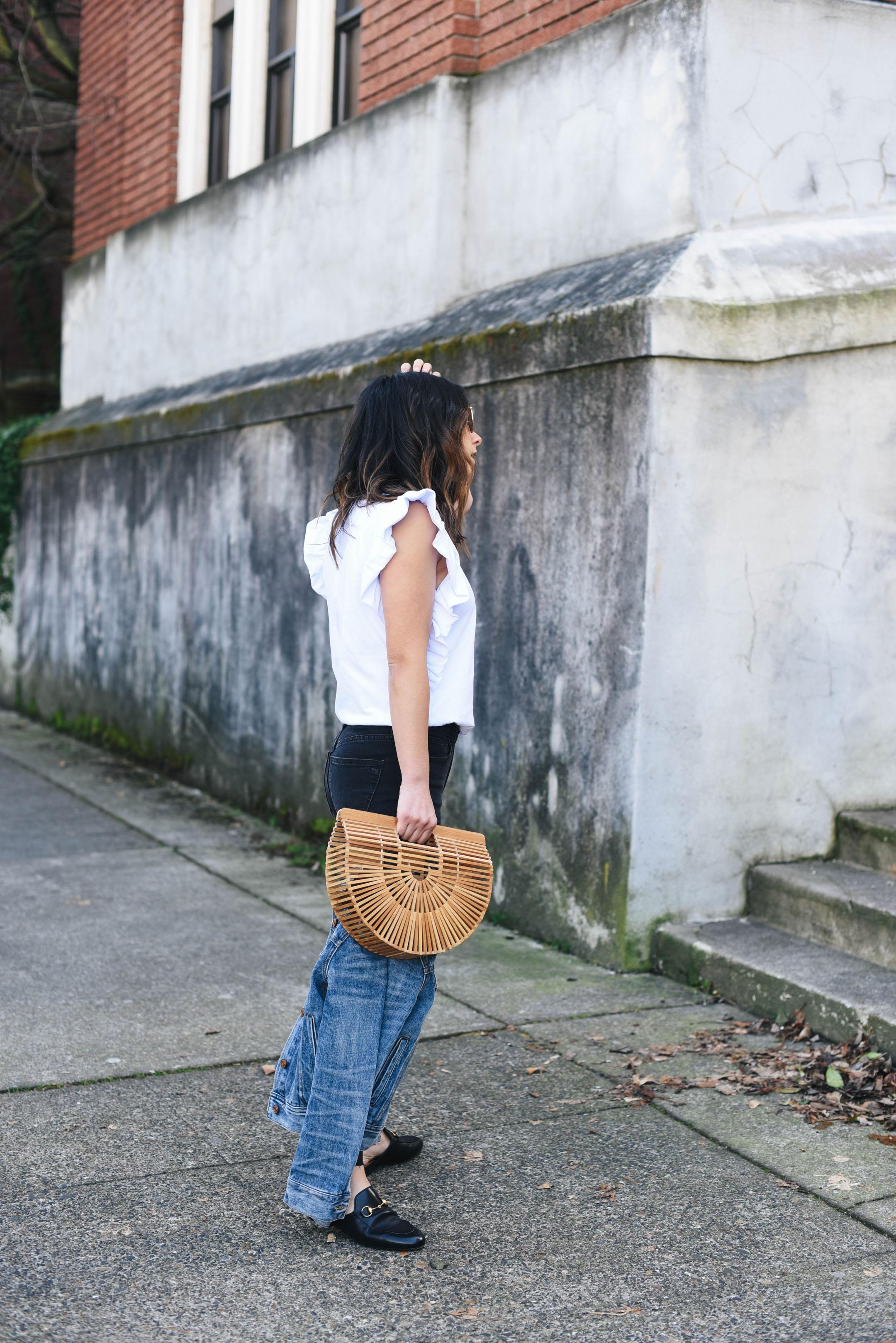 Crystalin Marie wearing Cult Gaia ark bag