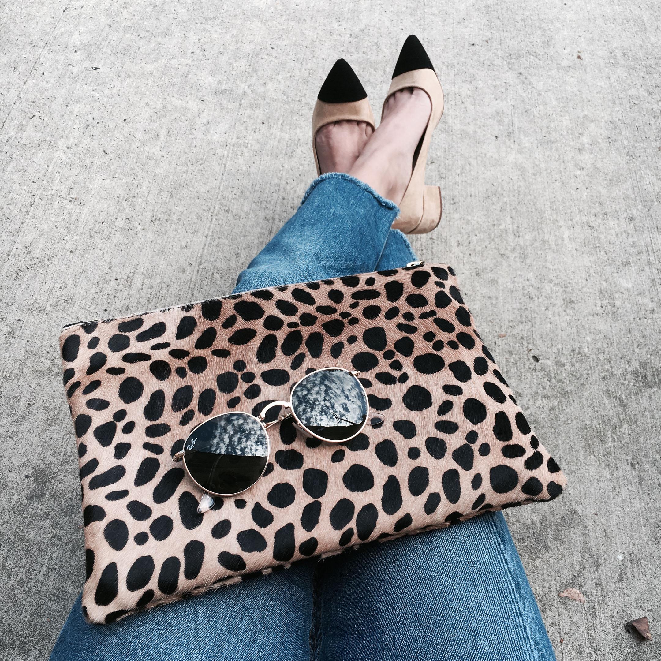 clare vivier leopard flat clutch
