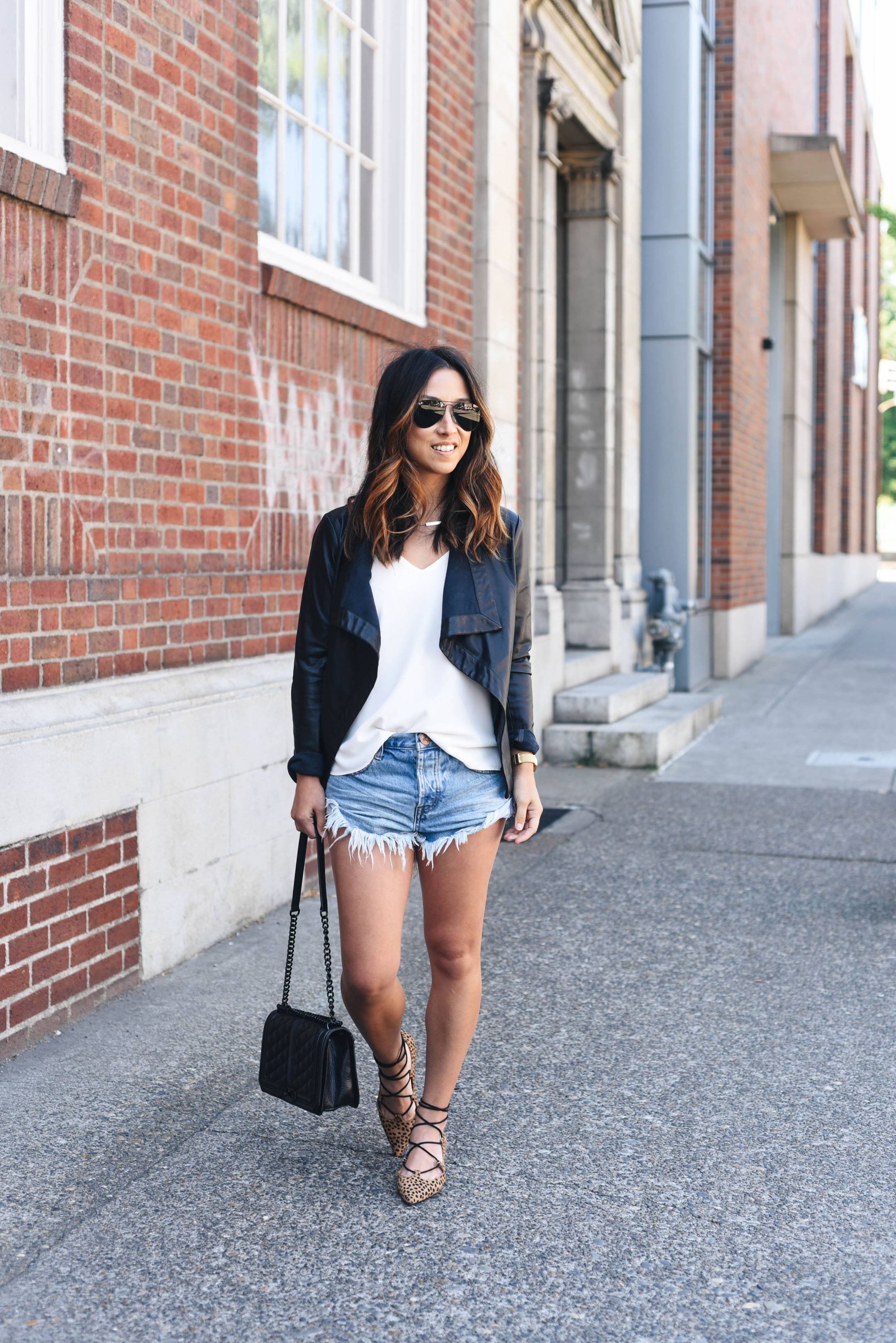 Leather jacket and denim cutoffs